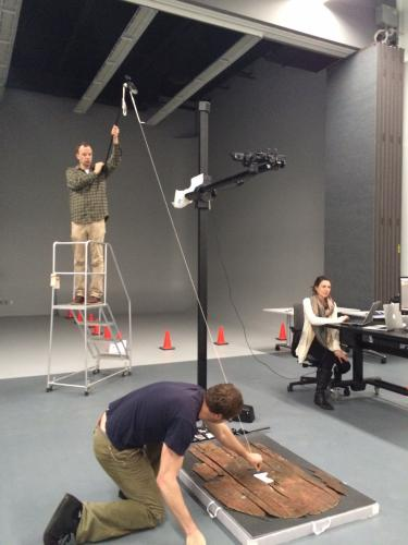 Pablo Londero and Jens Stenger orient lighting while Erin Mysak operates the camera for imaging of a wooden Roman Shield (YUAG accession #: 1935.551)