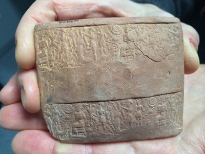 The obverse side of an Old Assyrian envelope fragment decorated with impressions created by a cylinder seal.