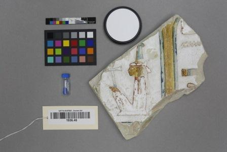 YUAG 1936.45 Visible light, painted limestone relief depicting Maat. Vial of Egyptian blue pigment on the left. (photo credit: Jens Stenger)