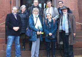 Yale delegation in front of the Smithsonian Castle (L to R): Matthew Jacobson, Laura Wexler, Lynn Cooley, Stefan Simon, Mary Miller, David Skelly and  Richard Bribiescas with Richard Kurin (Under Secretary for History, Art, and Culture, Smithsonian Institution)