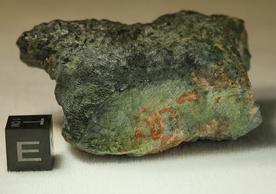 Artistic rendering of the Mercurian meteorite by Michael Anderson. Image taken by Fred E. Davis and provided courtesy of the Yale Peabody Museum; side of cube is 1 cm