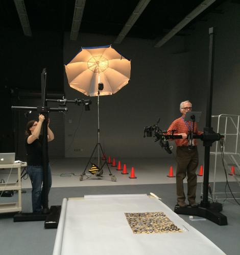 Photographer Bill Guth and Museum Assistant Rebekah DeAngelo set up for photography of a bark tapa cloth.
